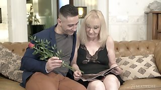 Unsightly granny Nanney is having sex fun with hot blooded young lover