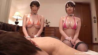 Oiled on every side busty Japanese Takarada Monami shres cock with her girlfriend