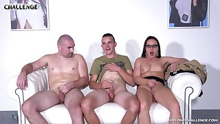 Wendy Moon seduces two guys and sucks their cocks on along to couch