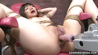 Throughout naked and tied up Asian slut gets pussy drilled on every side a sex machine