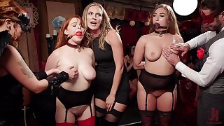 Redhead Penny Pax tied up, ball gagged and misused in public
