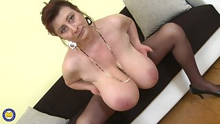 Buxom MILF Jana P. licks together with plays with her humongous boobs