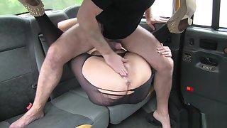 Seducing busty lady having fun wide stockings