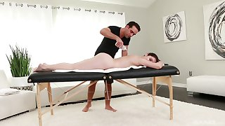 Oiled Keira Croft gets her pussy banged by a coxcomb on the massage table