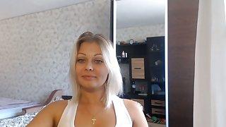 Blonde Babe Showing Irregular Smile Plus Breasts