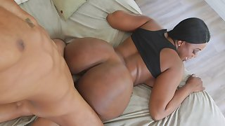 A huge ass dark-skinned chick is obtaining fucked and cumshot on the bed